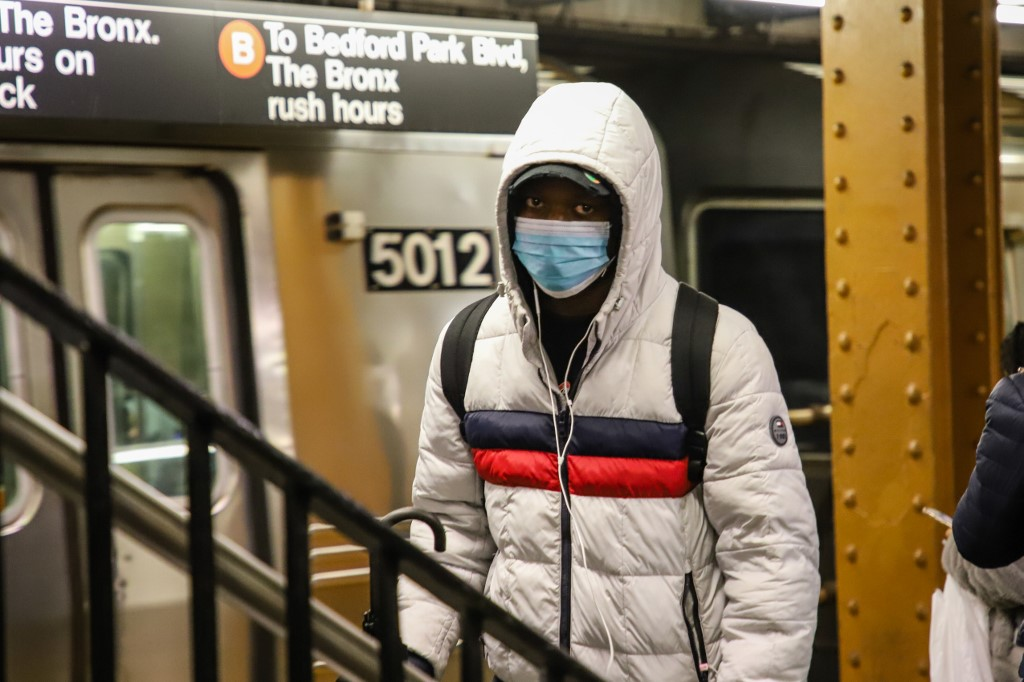 People wearing medical masks are seen on the New York subway during a Coronavirus Covid-19 pandemic in the United States