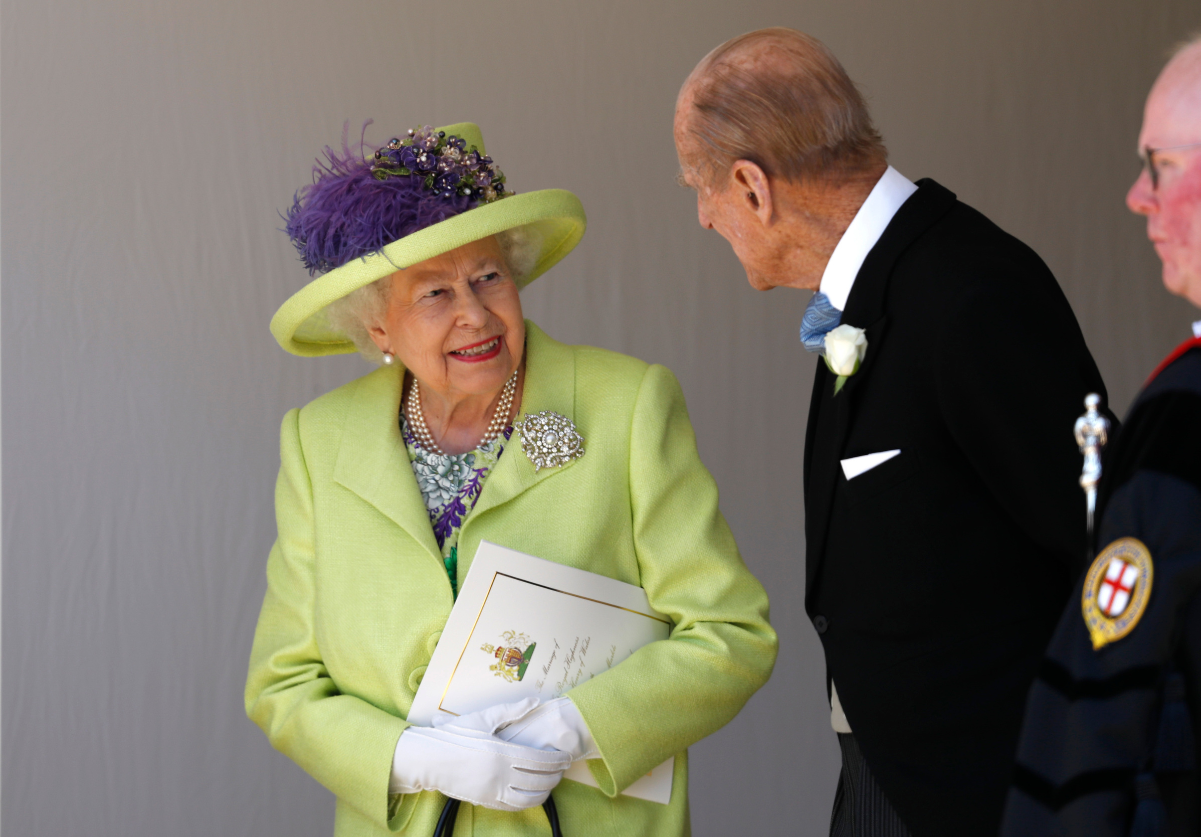 WINDSOR, UNITED KINGDOM - MAY 19:  Queen Elizabeth II talks with Prince Philip, Duke of Edinburgh after the wedding of Prince Harry and Meghan Markle at St George's Chapel at Windsor Castle on May 19, 2018 in Windsor, England. (Photo by Alastair Grant - WPA Pool/Getty Images)