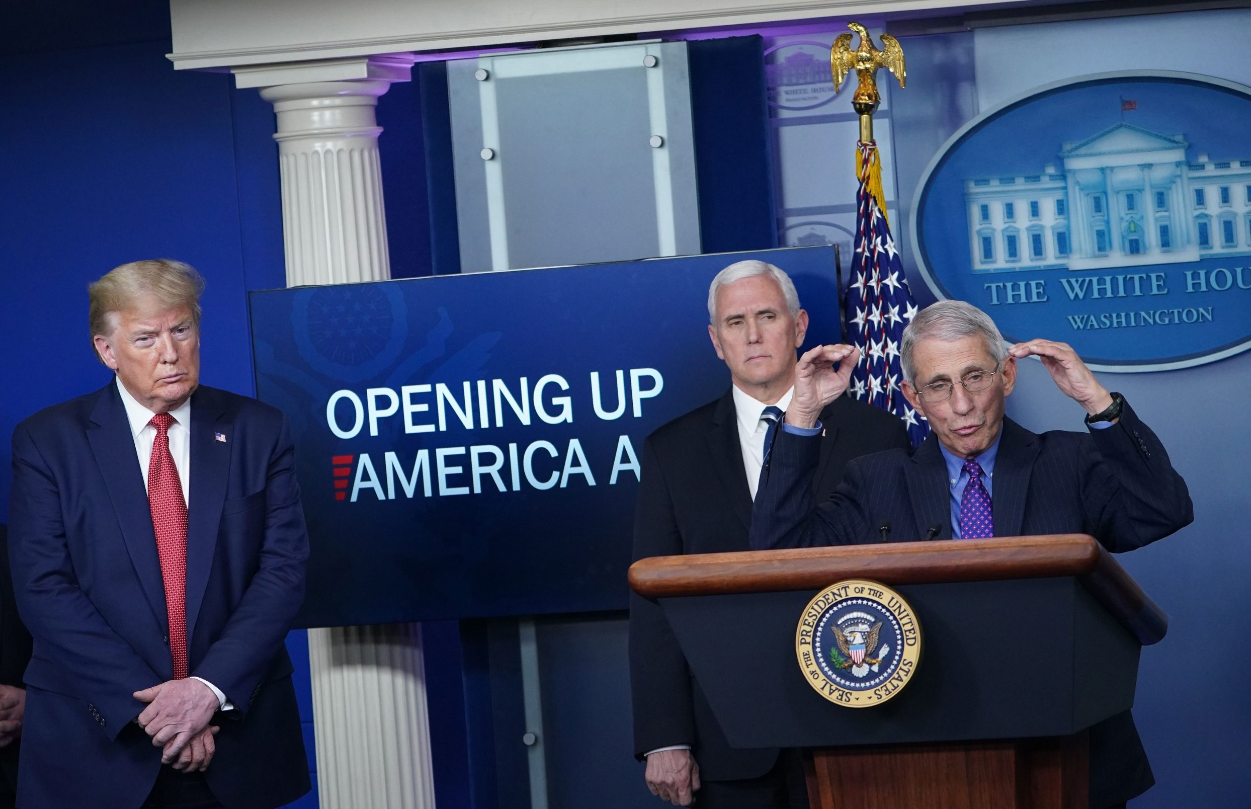 Director of the National Institute of Allergy and Infectious Diseases Anthony Fauci speaks as US President Donald Trump and US Vice President Mike Pence listen during the daily briefing on the novel coronavirus, which causes COVID-19, in the Brady Briefing Room of the White House on April 16, 2020, in Washington, DC. (Photo by MANDEL NGAN / AFP)
