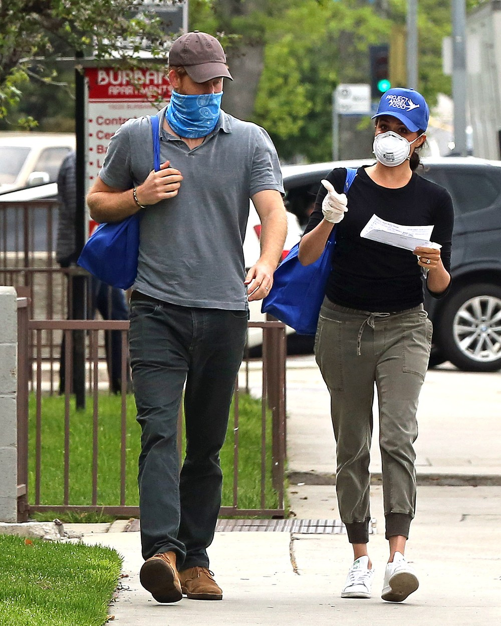 *PREMIUM EXCLUSIVE STRICTLY NO WEB UNTIL 1300 EDT 19TH APR* Prince Harry and Meghan Markle are seen in LA wearing masks as they deliver meals to residents in need during the COVID-19 pandemic. The couple were pictured delivering packages after volunteering with the non-profit organisation Project Angel Food. The former Duke and Duchess of Sussex were seen linking arms and holding hands after dropping off deliveries to addresses in their new city. Mandatory Credit: P&P/Rachpoot/MEGA. 17 Apr 2020, Image: 514274030, License: Rights-managed, Restrictions: World Rights, Model Release: no, Credit line: P&P/Rachpoot/MEGA / The Mega Agency / Profimedia
