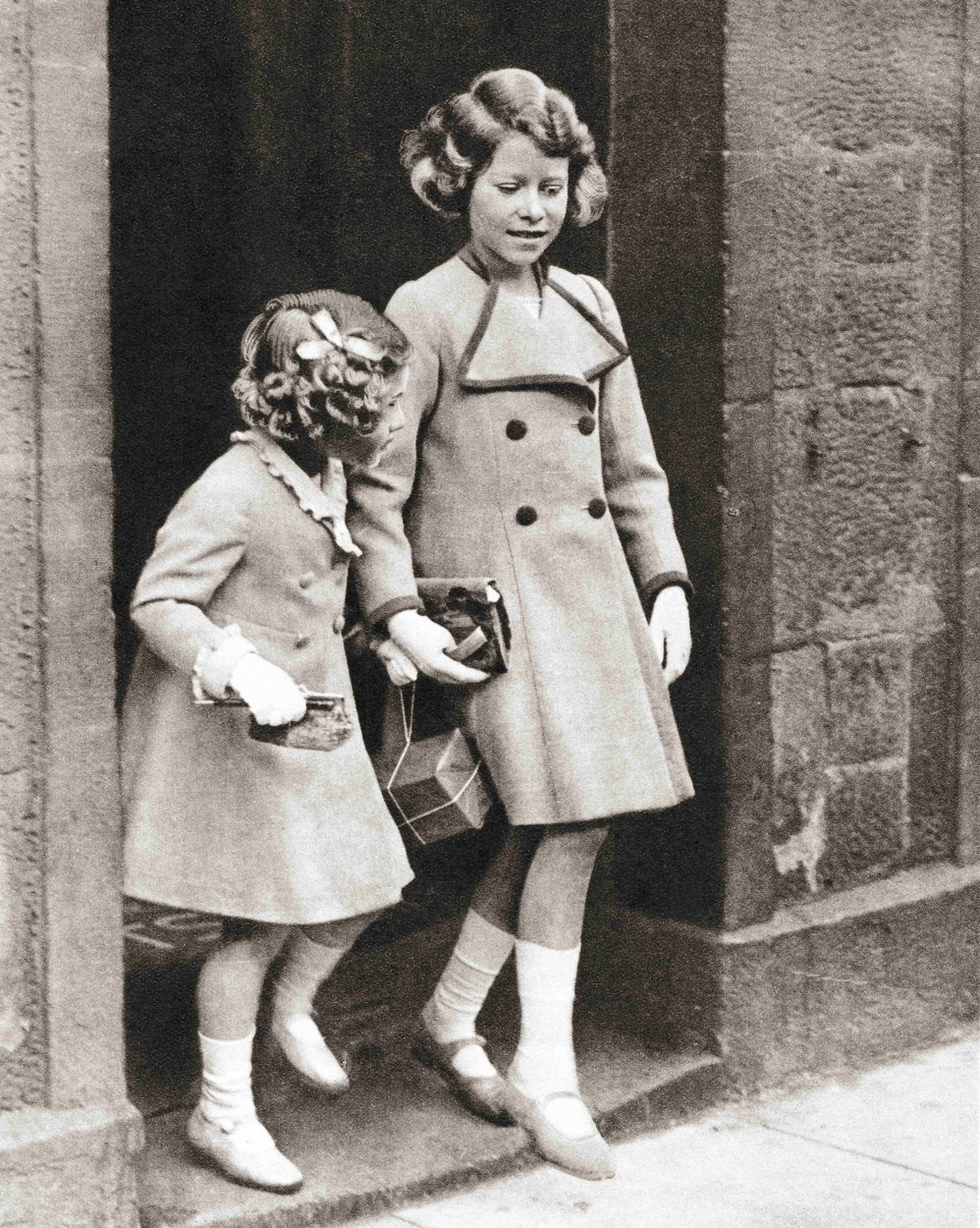 September 6, 2017: Princess Elizabeth, right, and her sister Princess Margaret in 1935.  Princess Elizabeth of York, future Elizabeth II,  born 1926. Queen of the United Kingdom. Princess Margaret, future Countess of Snowden, 1930 – 2002.  From The Coronation Book of King George VI and Queen Elizabeth, published 1937., Image: 489636770, License: Rights-managed, Restrictions: , Model Release: no, Credit line: Ken Welsh / Zuma Press / Profimedia