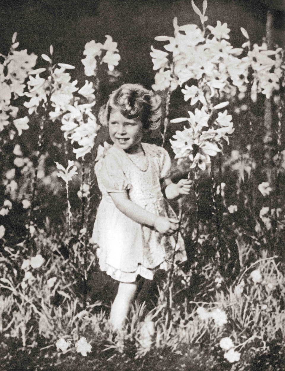 September 14, 2017: Princess Elizabeth of York aged 4, seen here in a photograph taken by her father King George VI. Princess Elizabeth of York, future Elizabeth II,  born 1926. Queen of the United Kingdom. From The Coronation Book of King George VI and Queen Elizabeth, published 1937., Image: 489637316, License: Rights-managed, Restrictions: , Model Release: no, Credit line: Ken Welsh / Zuma Press / Profimedia