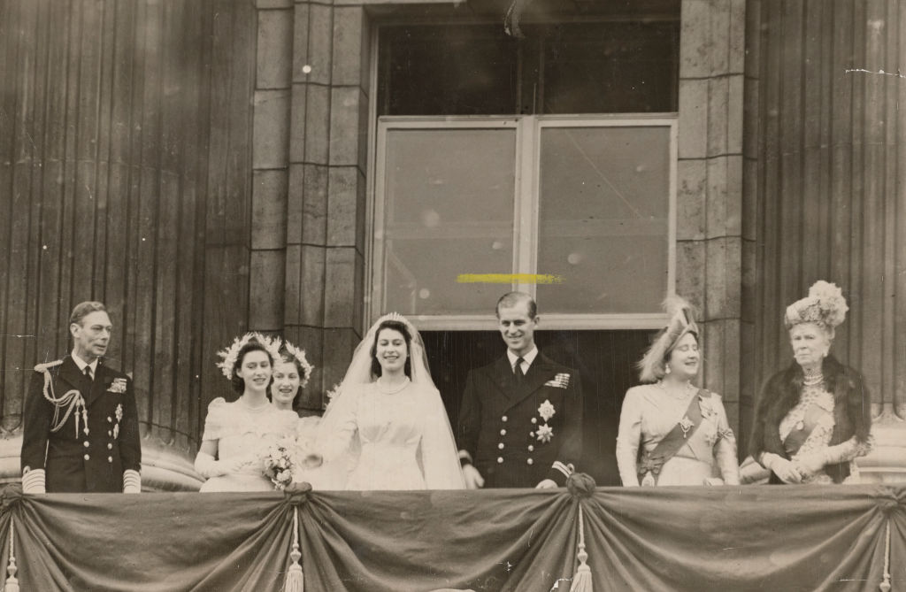 Members of the British royal family on the balcony at Buckingham Palace after the wedding of Princess Elizabeth and  (later Queen Elizabeth II and Prince Philip, Duke of Edinburgh), London, 20th November 1947. Left to right: King George VI, Princess Margaret, Lady Mary Cambridge, Elizabeth, Philip, Queen Elizabeth (later Queen Mother) and Queen Mary. (Photo by Evening Standard/Hulton Archive/Getty Images)