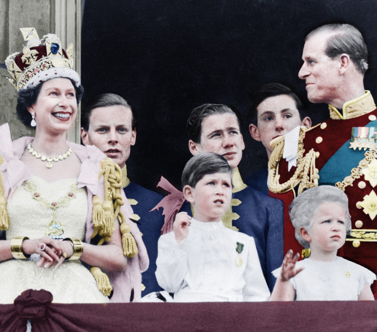 LONDON, UK: A colourised image showing how the Royal family celebrate the coronation of Queen Elizabeth II at  Palace, front row from left to right, Queen Elizabeth, Prince Charles, Princess Anne, Prince Phillip. 1953. STUNNING COLOURISED PHOTOS from a new photobook Retrographic show the day the Queen was coronated with husband Philip by her side have emerged this week, on the Royal couple's platinum wedding anniversary. Photos from the couple's 70 years as husband and wife show the two at a string of state visits from around the world, with one image showing the two posing for a picture with former U.S. President John F Kennedy and first lady Jackie. / Public Domain / mediadrumworld.com, Image: 355777891, License: Rights-managed, Restrictions: , Model Release: no, Credit line: Public Domain / mediadrumworld.c / Media Drum World / Profimedia