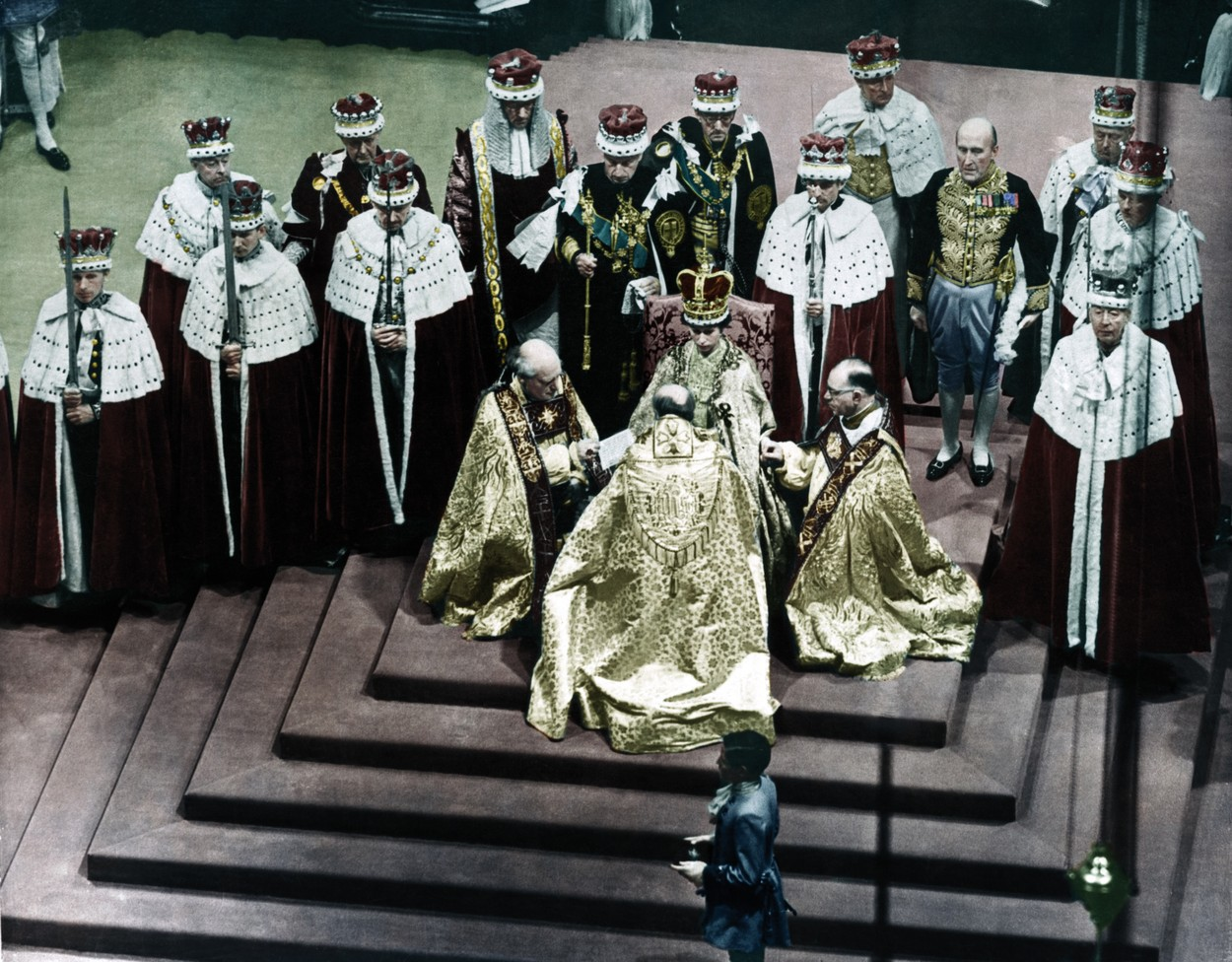 Westminster Cathedral, London, UK: A colourised image of Queen Elizabeth II during the coronation, surrounded by her bishops. STUNNING COLOURISED PHOTOS from a new photobook Retrographic show the day the Queen was coronated with husband Philip by her side have emerged this week, on the Royal couple's platinum wedding anniversary. Photos from the couple's 70 years as husband and wife show the two at a string of state visits from around the world, with one image showing the two posing for a picture with former U.S. President John F Kennedy and first lady Jackie. / Public Domain / mediadrumworld.com, Image: 355777897, License: Rights-managed, Restrictions: , Model Release: no, Credit line: Public Domain / mediadrumworld.c / Media Drum World / Profimedia