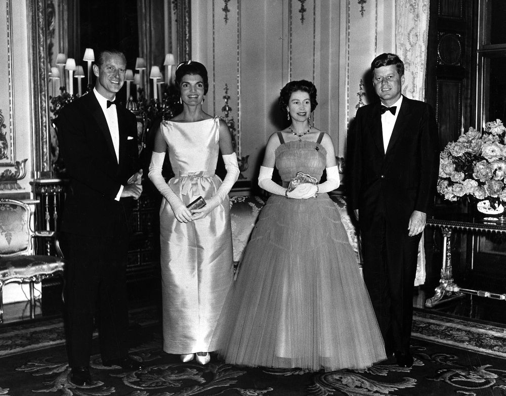 Prince Phillip and Queen elizabeth play host to Jackie Kennedy and President Kennedy at Buckingham Palace 1961. STUNNING COLOURISED PHOTOS from a new photobook Retrographic show the day the Queen was coronated with husband Philip by her side have emerged this week, on the Royal couple's platinum wedding anniversary. Photos from the couple's 70 years as husband and wife show the two at a string of state visits from around the world, with one image showing the two posing for a picture with former U.S. President John F Kennedy and first lady Jackie. / Public Domain / mediadrumworld.com, Image: 355777904, License: Rights-managed, Restrictions: , Model Release: no, Credit line: Public Domain / mediadrumworld.c / Media Drum World / Profimedia