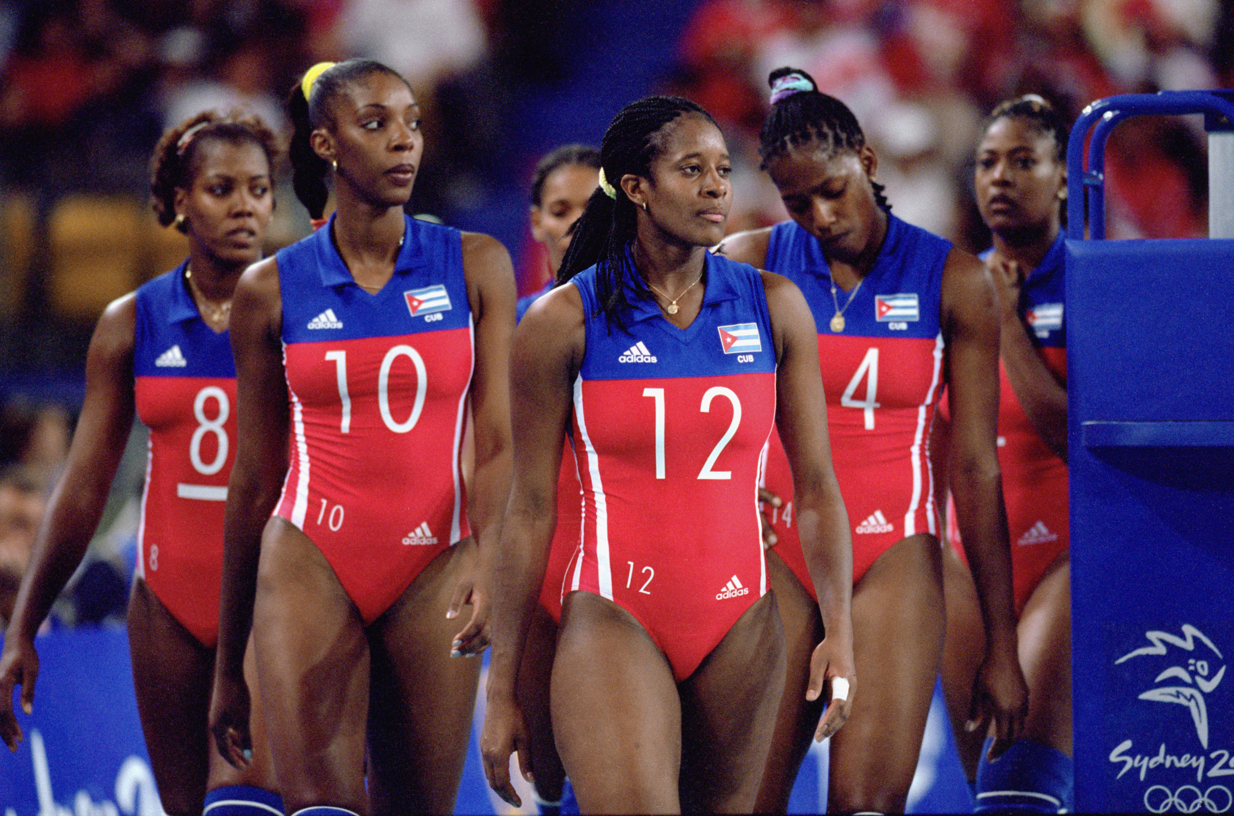 SYDNEY, AUSTRALIA - SEPTEMBER 16:  Taimarys Aguero #12 of Cuba leads her team onto the court during the Olympic Women's Indoor Volleyball competition at the Sydney Entertainment Centre in Sydney, Australia on September 16, 2000.  (Photo by Doug Pensinger/Getty Images)