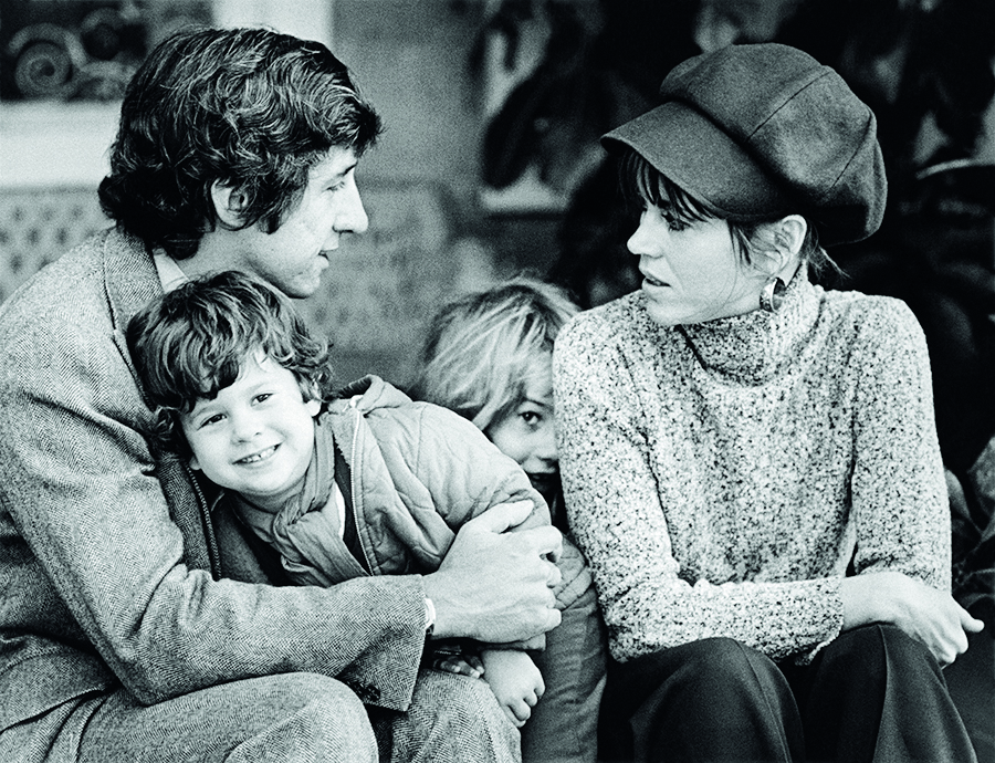 SANTA MONICA, CA - 1975:  Academy Award-winning actress Jane Fonda poses on the veranda of her home with husband Tom Hayden, son Troy Garity, and daughter Vanessa Vadim (hiding) in this 1975 Santa Monica, California, photo family portrait session. (Photo by George Rose/Getty Images)