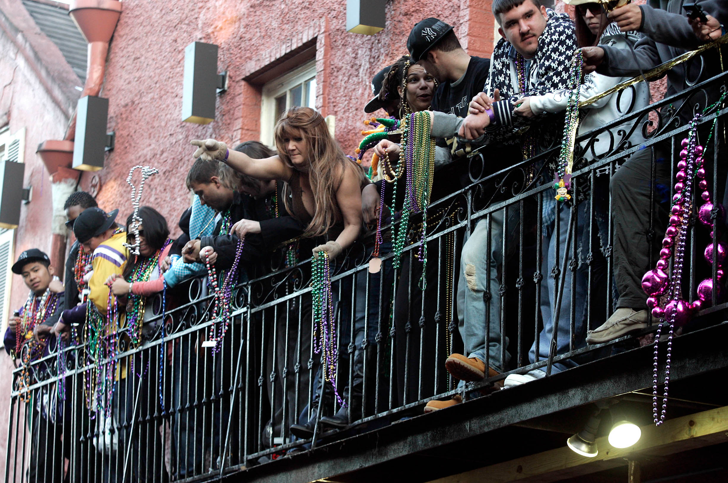 NEW ORLEANS - FEBRUARY 16: Revelers watch over Bourbon Street in the French Quarter from a balcony during Mardi Gras day on February 16, 2010 in New Orleans, Louisiana. The annual Mardi Gras celebration ends at midnight, when the Catholic Lenten season begins on Ash Wednesday and ends on Easter Sunday. (Photo by Patrick Semansky/Getty Images)