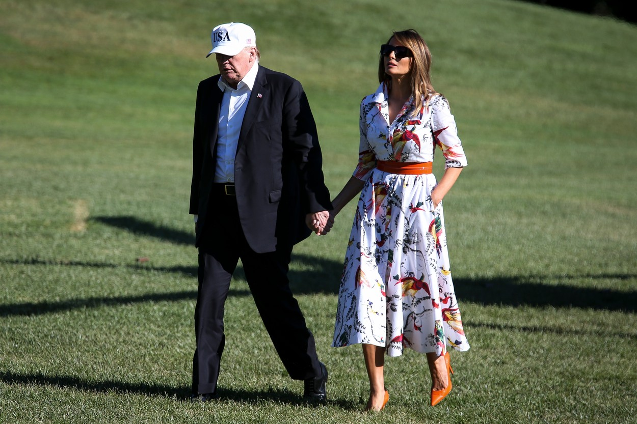 United States President Donald J. Trump and first lady Melania Trump hold hands as they cross the South Lawn upon arrival at the White House on July 8, 2018 in Washington, DC. The First Family spent the weekend at the Trump National Golf Club in Bedminster Township, New Jersey., Image: 377326564, License: Rights-managed, Restrictions: WORLD RIGHTS - Fee Payable Upon Reproduction - For queries contact Avalon.red - sales@avalon.red London: +44 (0) 20 7421 6000 Los Angeles: +1 (310) 822 0419 Berlin: +49 (0) 30 76 212 251 Madrid: +34 91 533 4289, Model Release: no, Credit line: Avalon.red / Avalon Editorial / Profimedia