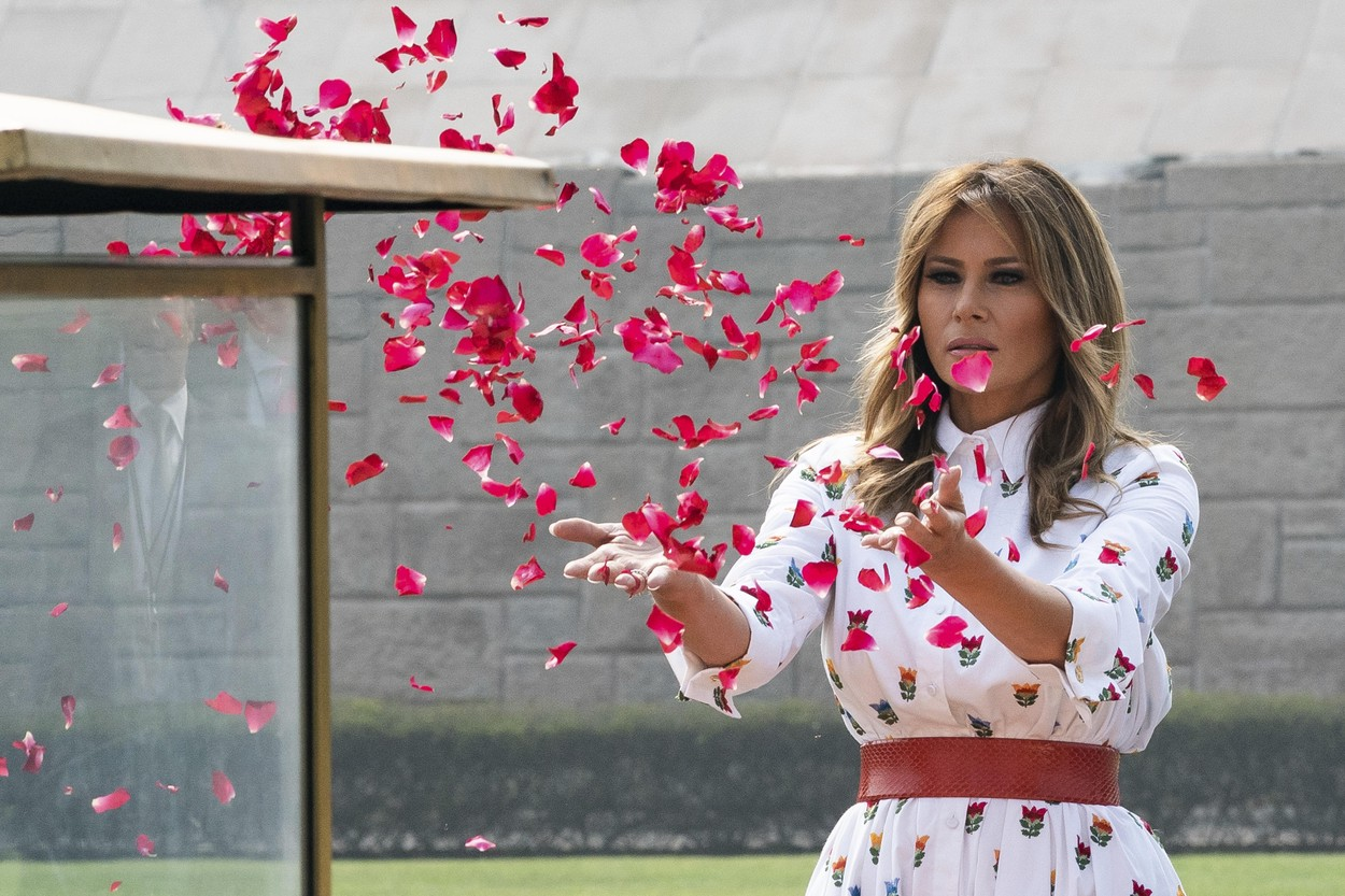 February 25, 2020, New Delhi, New Delhi, India: U.S. First Lady Melania Trump scatters rose petals in honor of Mahatma Gandhi during a wreath laying ceremony at Raj Ghat February 25, 2020 in New Delhi, India., Image: 502536656, License: Rights-managed, Restrictions: , Model Release: no, Credit line: Andrea Hanks/White House / Zuma Press / Profimedia