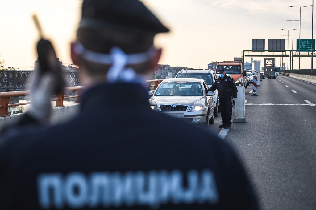 Police officers check drivers at the E75 highway through Belgrade on April 10, 2020, as Serbia has introduced curfew from Friday 5 pm to Sunday 5 am (first time for a total of 60 hours) for entire population except those authorised and night shift workers, in a bid to fight the COVID-19 disease caused by the novel coronavirus. (Photo by Andrej ISAKOVIC / AFP)