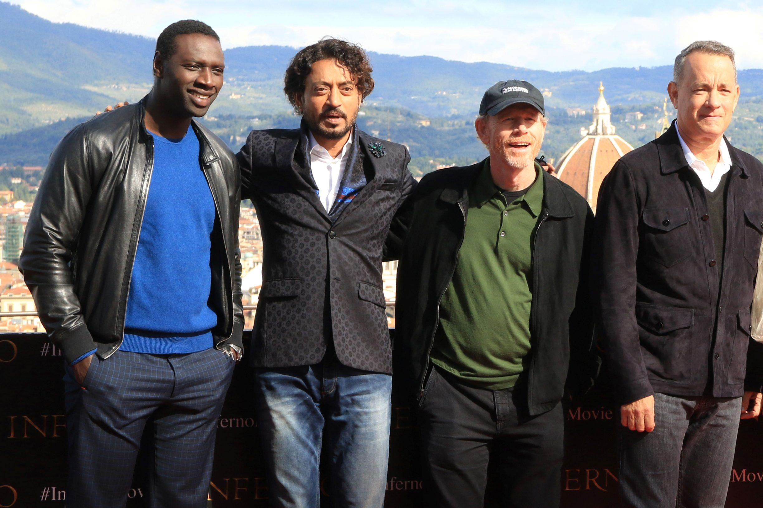 (FILES) In this file photo taken on October 07, 2016 (L-R) actors Omar Sy, Irrfan Khan, director Ron Howard and actor Tom Hanks pose during a photocall on the eve of the World Premiere of the movie