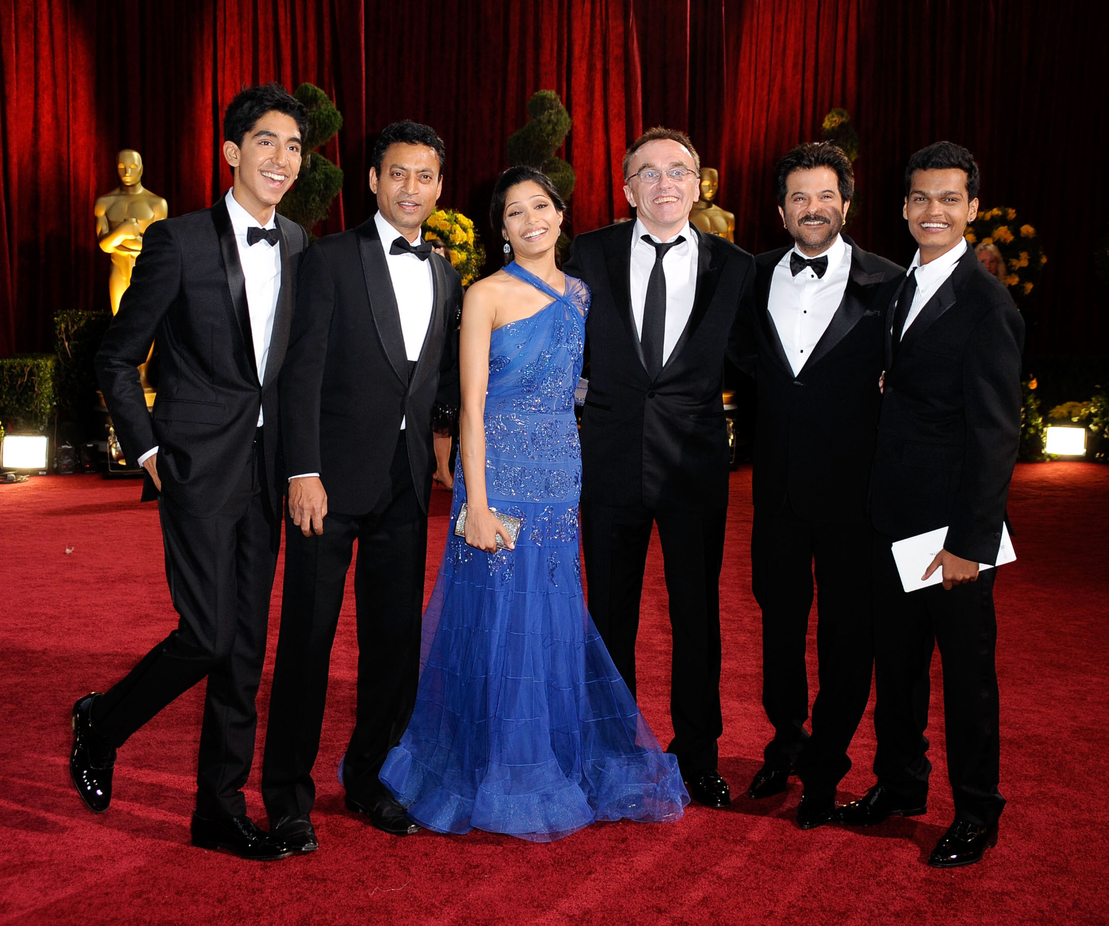 LOS ANGELES, CA - FEBRUARY 22:  (L-R) Actors Dev Patel, Irrfan Khan and Freida Pinto, director Danny Boyle actors Anil Kapoor and Madhur Mittal arrive at the 81st Annual Academy Awards held at Kodak Theatre on February 22, 2009 in Los Angeles, California.  (Photo by Frazer Harrison/Getty Images)