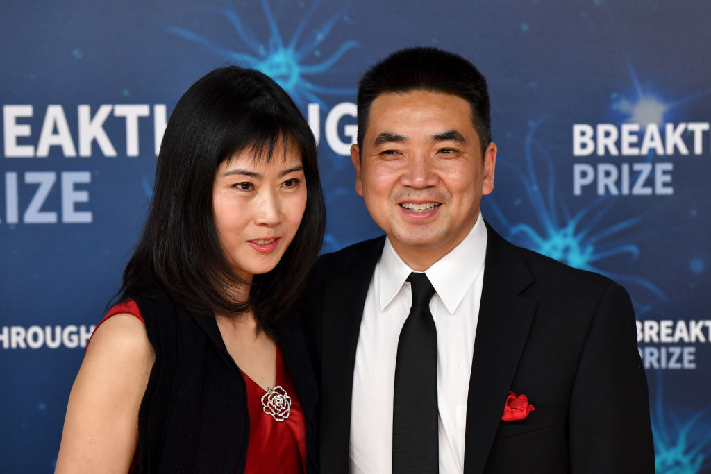 MOUNTAIN VIEW, CALIFORNIA - NOVEMBER 03: A guest and Eric Yuan (R) attend the 2020 Breakthrough Prize Red Carpet at NASA Ames Research Center on November 03, 2019 in Mountain View, California. (Photo by Ian Tuttle/Getty Images  for Breakthrough Prize )