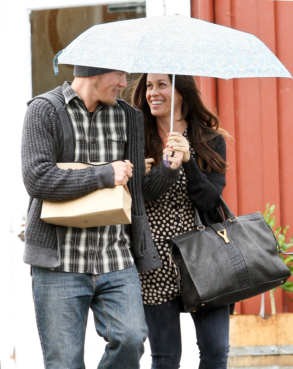 "#8275221 Songstress Alanis Morissette cuddled up to her husband Mario ""MC Souleye"" Treadway under an umbrella in an attempt to stay dry after lunch at the Brentwood Country Mart in Los Angeles, California on December 12, 2011., Image: 109126079, License: Rights-managed, Restrictions: , Model Release: no, Credit line: Fame Pictures / Backgrid USA / Profimedia"