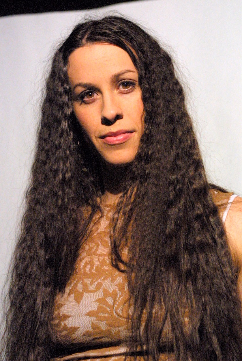February, 2002, Montreal, Quebec, Canada Recording artist Alanis Morissette pose for photographers, before a conference about  her new album