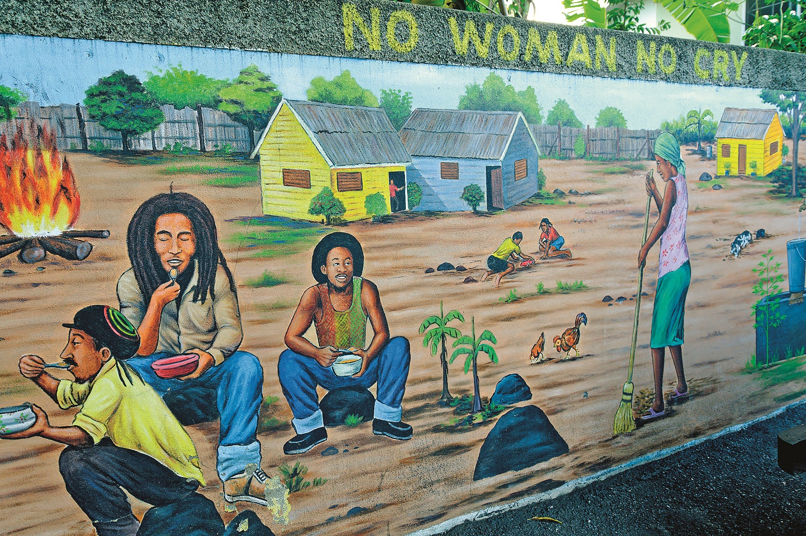 Jamaica, Surrey County, Parish of Kingston, Kingston, Bob Marley Museum, mural painted by the artist Jimmy Stewart featuring the traditional life of a village in Jamaica