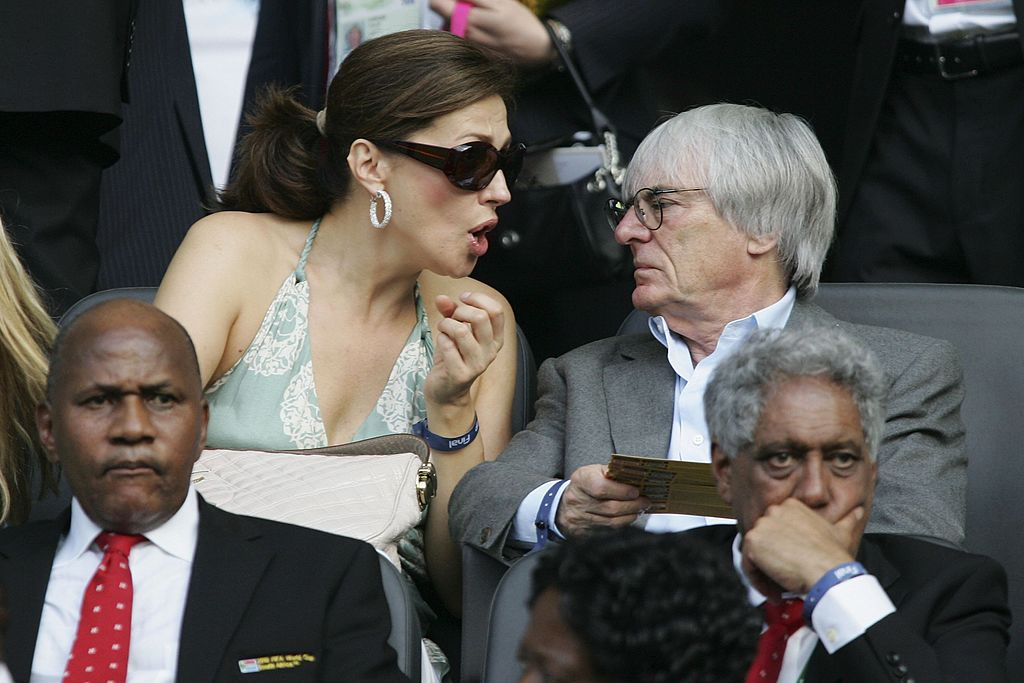 BERLIN - JULY 09:  Bernie Ecclestone (R) the Head of Formula One and his wife, Slavica speak during the FIFA World Cup Germany 2006 Final match between Italy and France at the Olympic Stadium on July 9, 2006 in Berlin, Germany.   (Photo by Andreas Rentz/Bongarts/Getty Images)