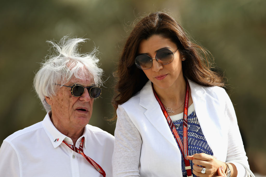 BAHRAIN, BAHRAIN - APRIL 08:  Bernie Ecclestone, Chairman Emeritus of the Formula One Group, talks in the Paddock with wife Fabiana before the Bahrain Formula One Grand Prix at Bahrain International Circuit on April 8, 2018 in Bahrain, Bahrain.  (Photo by Charles Coates/Getty Images)