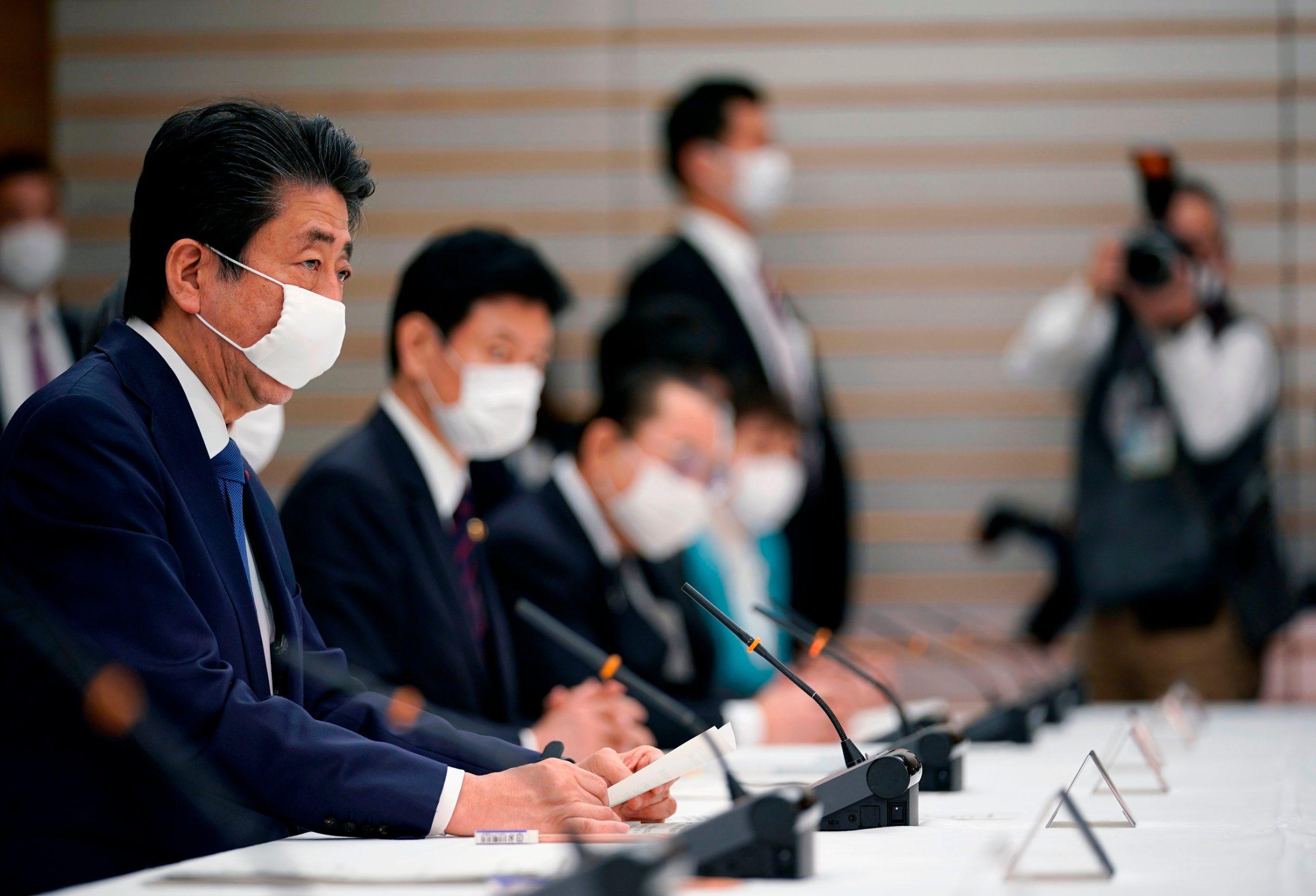 Shinzo Abe (L)
