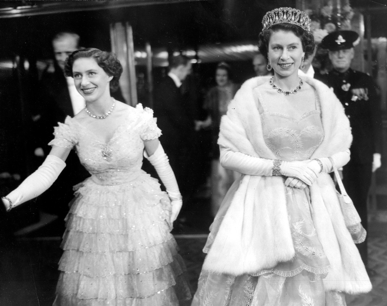 Oct 26, 1953 - London, England, UK - The elder daughter of King George VI and Queen Elizabeth, ELIZABETH WINDSOR (named Elizabeth II) became Queen at the age of 25, and has reigned through more than five decades of enormous social change and development. For more than 50 years, during a period of great social change, The Queen has carried out her political duties as Head of State, the ceremonial responsibilities of the Sovereign and an unprecedented programme of visits in the United Kingdom, Commonwealth and overseas. PICTURED: QUEEN ELIZABETH II with her sister PRINCESS MARGARET., Image: 210131630, License: Rights-managed, Restrictions: , Model Release: no, Credit line: KEYSTONE Pictures USA / Zuma Press / Profimedia