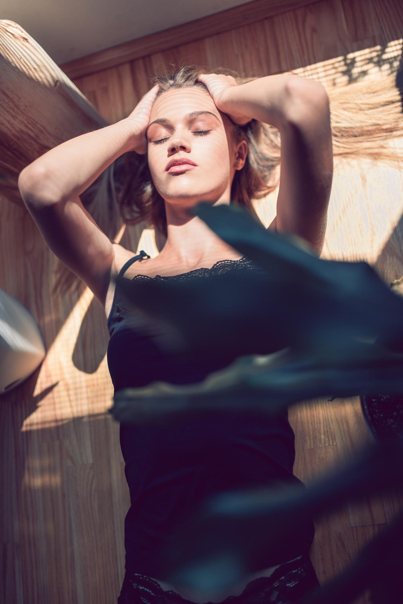 Female Getting Sum Widow Sunlight While Lying On Floor