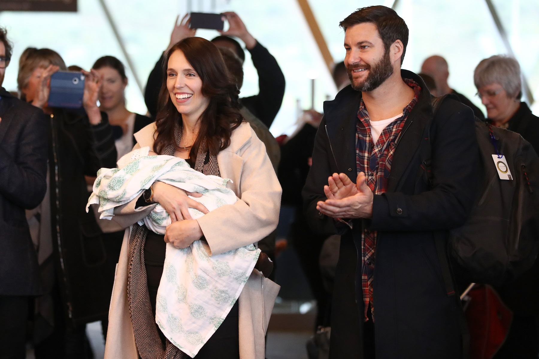 WELLINGTON, NEW ZEALAND - AUGUST 04:  New Zealand Prime Minister Jacinda Ardern arrives at Wellington Airport with her partner Clarke Gayford and their daughter Neve Gayford on August 4, 2018 in Wellington, New Zealand. Prime Minister Ardern and her partner Glarke Gayford welcomed their daughter Neve on 21 June 2018. Prime Minister Ardern is the second world leader to give birth in office, and the first elected leader to take maternity leave.  (Photo by Hannah Peters/Getty Images)