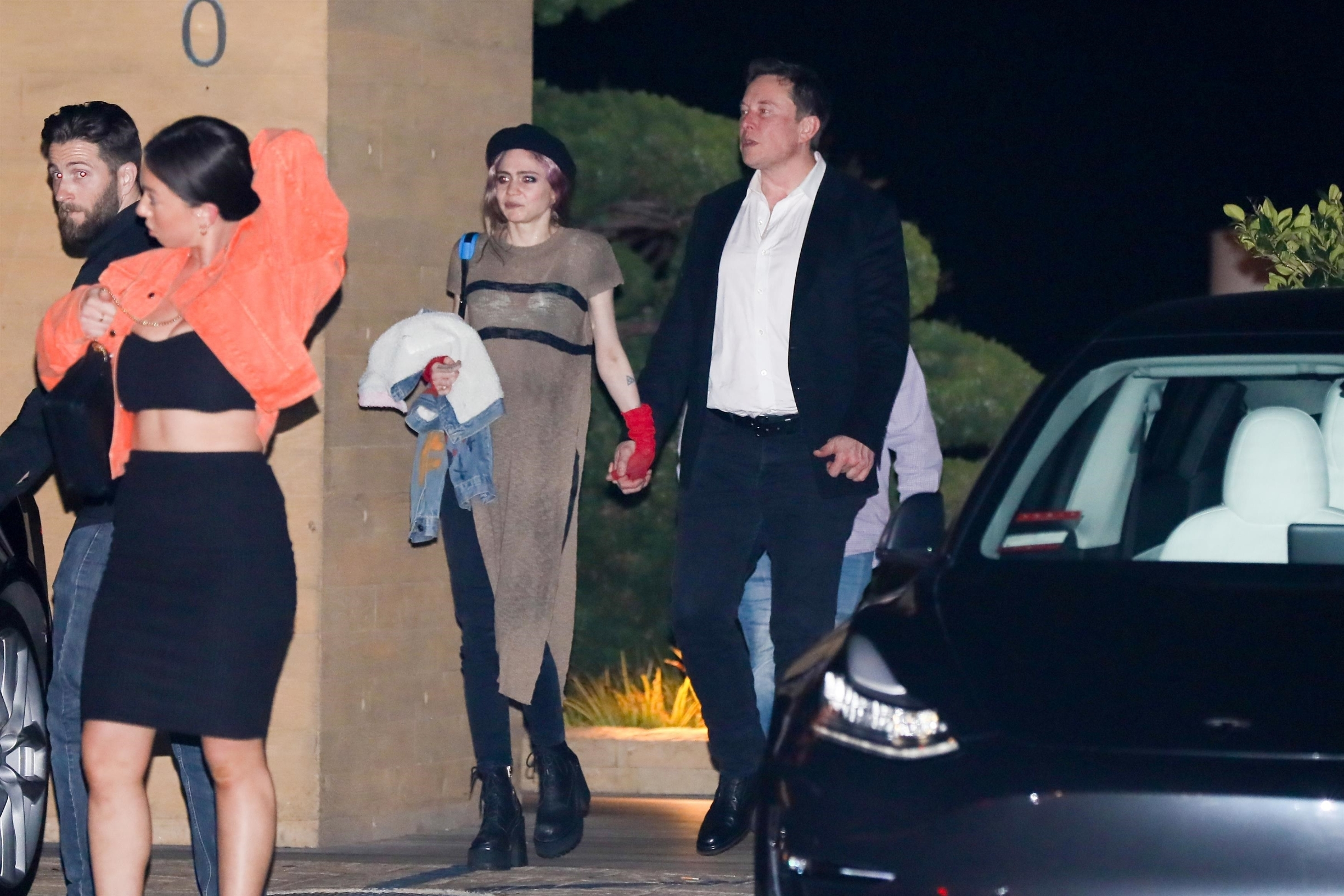 *EXCLUSIVE* Malibu, CA  - Elon Musk and girlfriend musician Grimes enjoy a dinner date at Nobu in Malibu with a couple friends,  Pictured: Elon Musk and Grimes    *UK Clients - Pictures Containing Children Please Pixelate Face Prior To Publication*, Image: 430791487, License: Rights-managed, Restrictions: , Model Release: no, Credit line: NGRE / BACKGRID / Backgrid USA / Profimedia