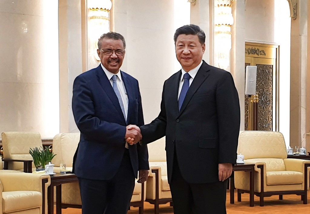 6148223 28.01.2020 Director-General of the World Health Organization Tedros Adhanom Ghebreyesus, left, shakes hands with China's President Xi Jinping, right during their meeting in Beijing, China. The head of the World Health Organization plans to discuss the situation with the coronavirus outbreak. The WHO is yet to declare a global health emergency in response to the crisis, although cases have been identified across the world including in the United States, France, Canada, South Korea, Taiwan, Thailand, Vietnam, Japan, Singapore, Nepal, and Australia. Anna Ratkoglo / Sputnik