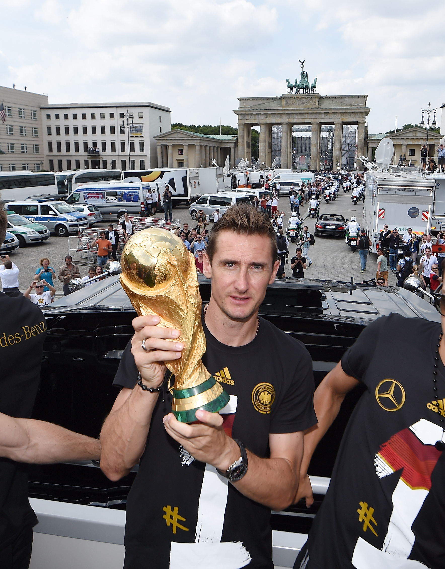 BERLIN, GERMANY - JULY 15: Miroslav Klose celebrates during the German team victory ceremony on July 15, 2014 in Berlin, Germany. Germany won the 2014 FIFA World Cup Brazil match against Argentina in Rio de Janeiro on July 13.  (Photo by Markus Gilliar - Pool /Getty Images)