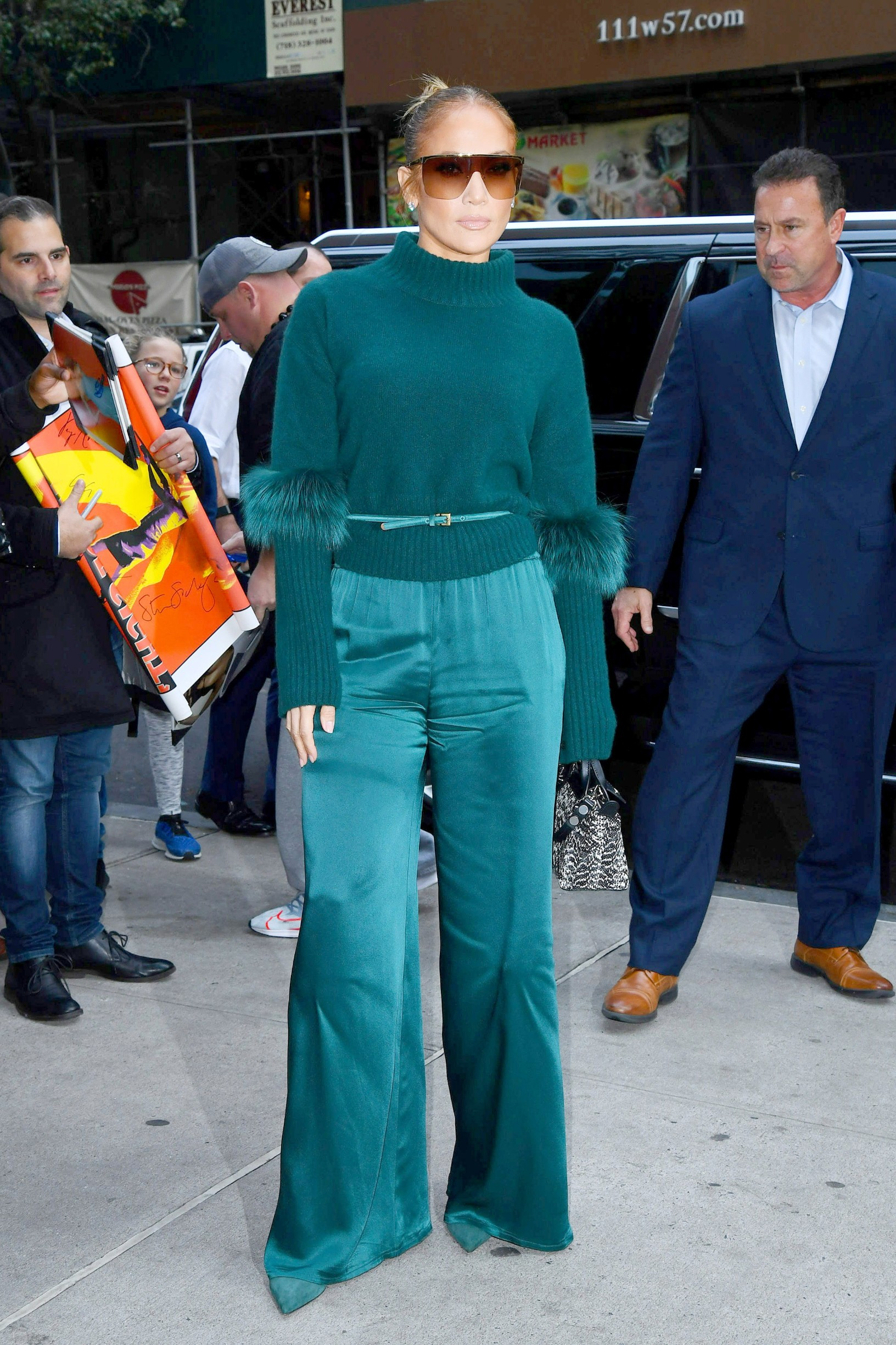 11/11/2019 Jennifer Lopez is pictured stepping out in New York City. The 50 year old actress and pop star wore a green sweater paired with matching silk bell bottom trousers., Image: 482326319, License: Rights-managed, Restrictions: NO usage without agreed price and terms. Please contact sales@theimagedirect.com, Model Release: no, Credit line: TheImageDirect.com / The Image Direct / Profimedia