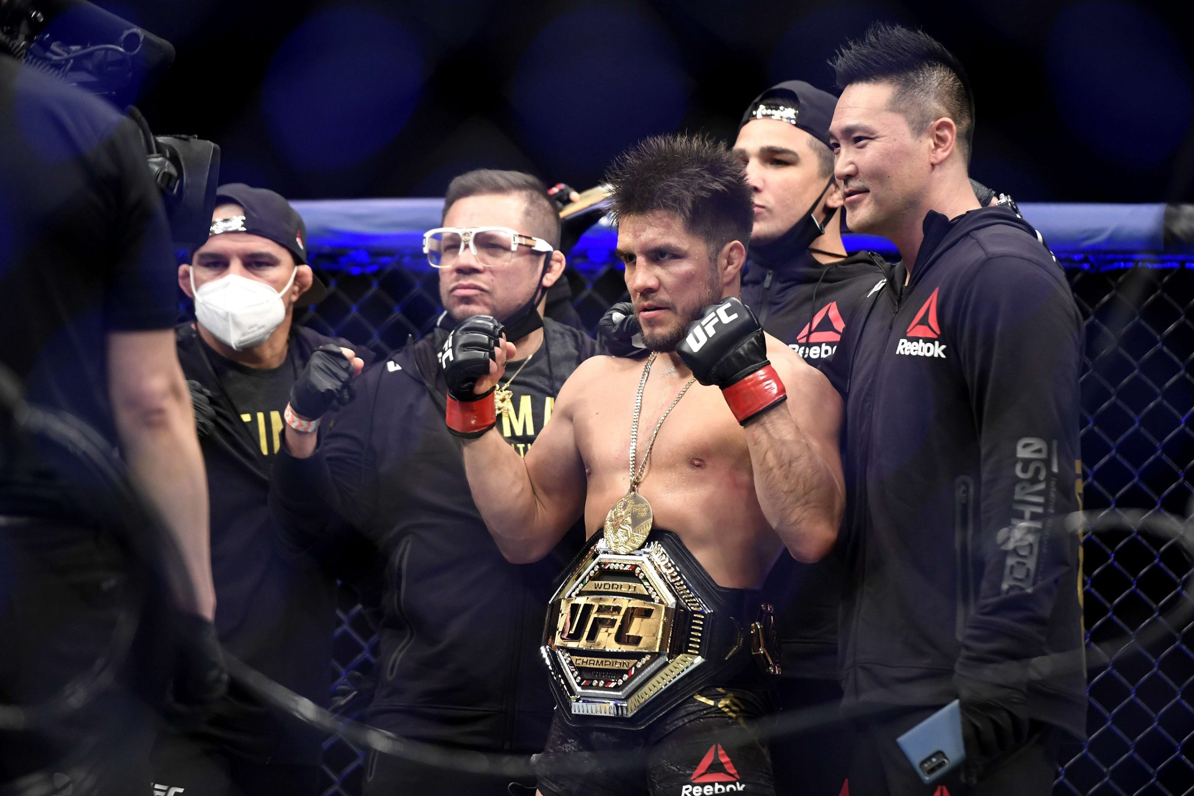 JACKSONVILLE, FLORIDA - MAY 09: Henry Cejudo (L) of the United States celebrates defeating Dominick Cruz (not pictured) of the United States in their bantamweight title fight during UFC 249 at VyStar Veterans Memorial Arena on May 09, 2020 in Jacksonville, Florida.   Douglas P. DeFelice/Getty Images/AFP == FOR NEWSPAPERS, INTERNET, TELCOS & TELEVISION USE ONLY ==