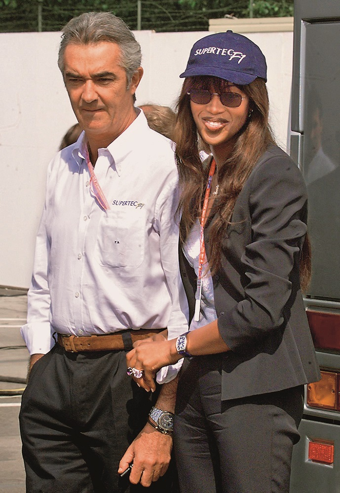 Italian Supertec chairman Flavio Briatore poses with his girlfriend British Super Model Naomi Campbell in the paddocks of the Imola racetrack, 02 May 1999 before the 19th San Marino Formula One Grand Prix. (ELECTRONIC IMAGE ), Image: 17445425, License: Rights-managed, Restrictions: , Model Release: no, Credit line: PATRICK HERTZOG / AFP / Profimedia