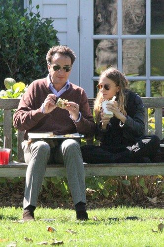 EXCLUSIVE TO INF. PLEASE CALL BEFORE USAGE. Septembe 19, 2014: Mary-Kate Olsen and Olivier Sarkozy, half-brother of the former President of France Nicolas Sarkozy, seen out in the Hamptons, New York.  Sarkozy fed Mary-Kate a sandwich and later both enjoyed a cigarette.  In a relationship since 2012, Olsen can be seen wearing her engagement ring from Sarkozy., Image: 205901942, License: Rights-managed, Restrictions: EXCLUSIVE TO INF. PLEASE CALL BEFORE USAGE., Model Release: no, Credit line: Matt Agudo / INSTAR Images / Profimedia