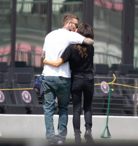 *PREMIUM EXCLUSIVE * David Beckham tenderly kisses wife Victoria as the entire family visits the temporary new home of his Miami football team. Brooklyn, 21, Romeo, 17, Cruz 15, and Harper, eight, joined their proud father for a personal tour of his team's stadium. Brooklyn, who turned 21 last week, packed on the PDA with American actress Nicola Peltz, 25, as did Romeo with his girlfriend Mia Regan. Victoria seemed to be having a ball and was seen dancing to music by the Spice Girls. The visit came after  fashion designer Victoria, 45, took to Instagram to update fans on her familys decision to travel to Miami to support husband David, also 45, for the launch of his football team Inter Miami CF. The former Manchester United and England star was just two games into the season when the Major Soccer League announced they have suspended their league season for the next 30 days because of coronavirus fears. 14 Mar 2020, Image: 506513429, License: Rights-managed, Restrictions: World Rights, Model Release: no, Credit line: Splash News/MEGA / The Mega Agency / Profimedia