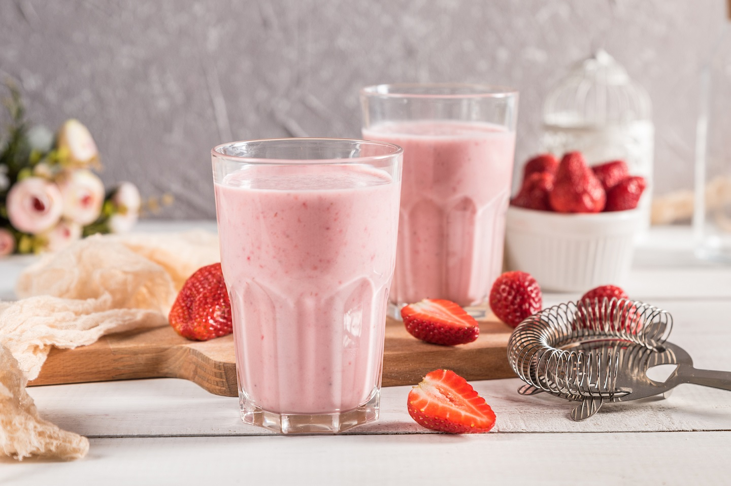 Fresh homemade strawberry smoothies on rustic background