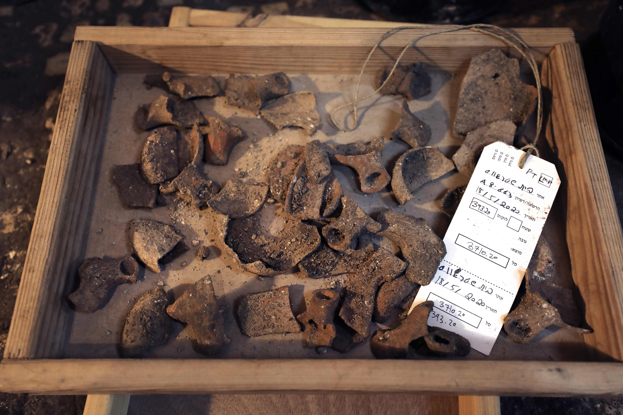 This picture taken on May 19, 2020 shows a view of ceramic fragments of oil lamps dating to the Jewish Second Temple period (6th century BCE-1st century CE), discovered at a subterranean system hewn in the bedrock beneath a 1400-year-old building near the Western Wall in Jerusalem's Old City. (Photo by MENAHEM KAHANA / AFP)