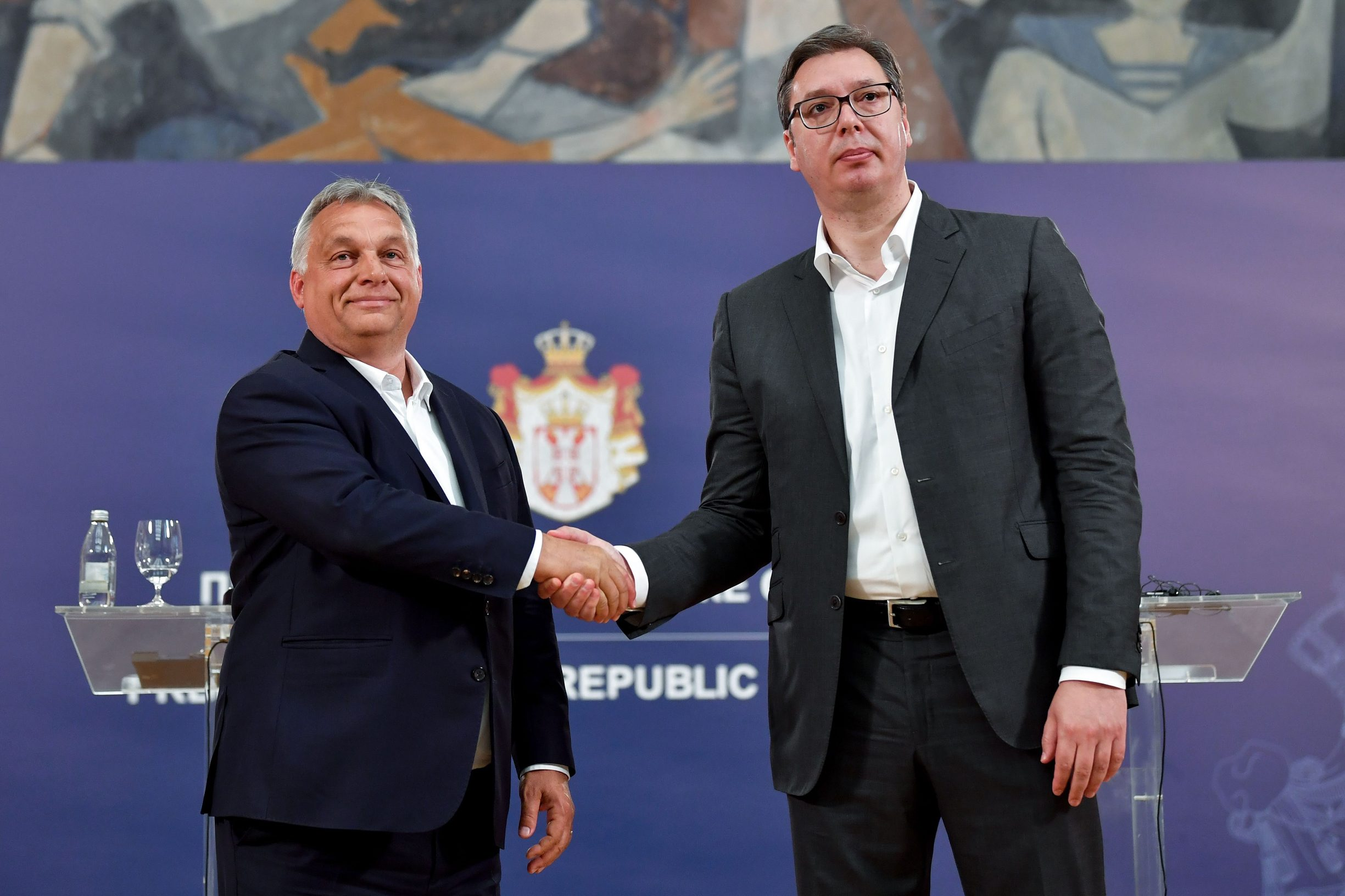 Serbian President Aleksandar Vucic (R) shakes hands with Hungarian Prime Minister Viktor Orban after a joint press conference in Belgrade on May 15, 2020. (Photo by Andrej ISAKOVIC / AFP)