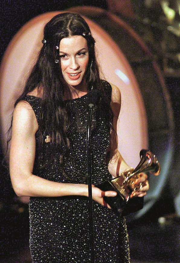 Canadian singer Alanis Morrisette receives her award for the Best Rock Vocal Performance at the 41st Grammy Awards at the Shrine Auditorium in Los Angeles 24 February. (DIGITAL IMAGE) AFP PHOTO/Hector MATA (Photo by HECTOR MATA / AFP)