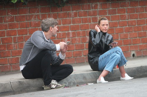 EXCLUSIVE: Jaime King takes a cigarette break outside a LA Studio and chat with her husband Kyle Newman while sitting on the curb of LA Street. Jamie was spotted sipping coffee off a mug featuring the logo of the Arsenal soccer team!. 31 May 2018, Image: 373508672, License: Rights-managed, Restrictions: NO Canada, United Kingdom, United States, Model Release: no, Credit line: FIA Pictures / MEGA / The Mega Agency / Profimedia