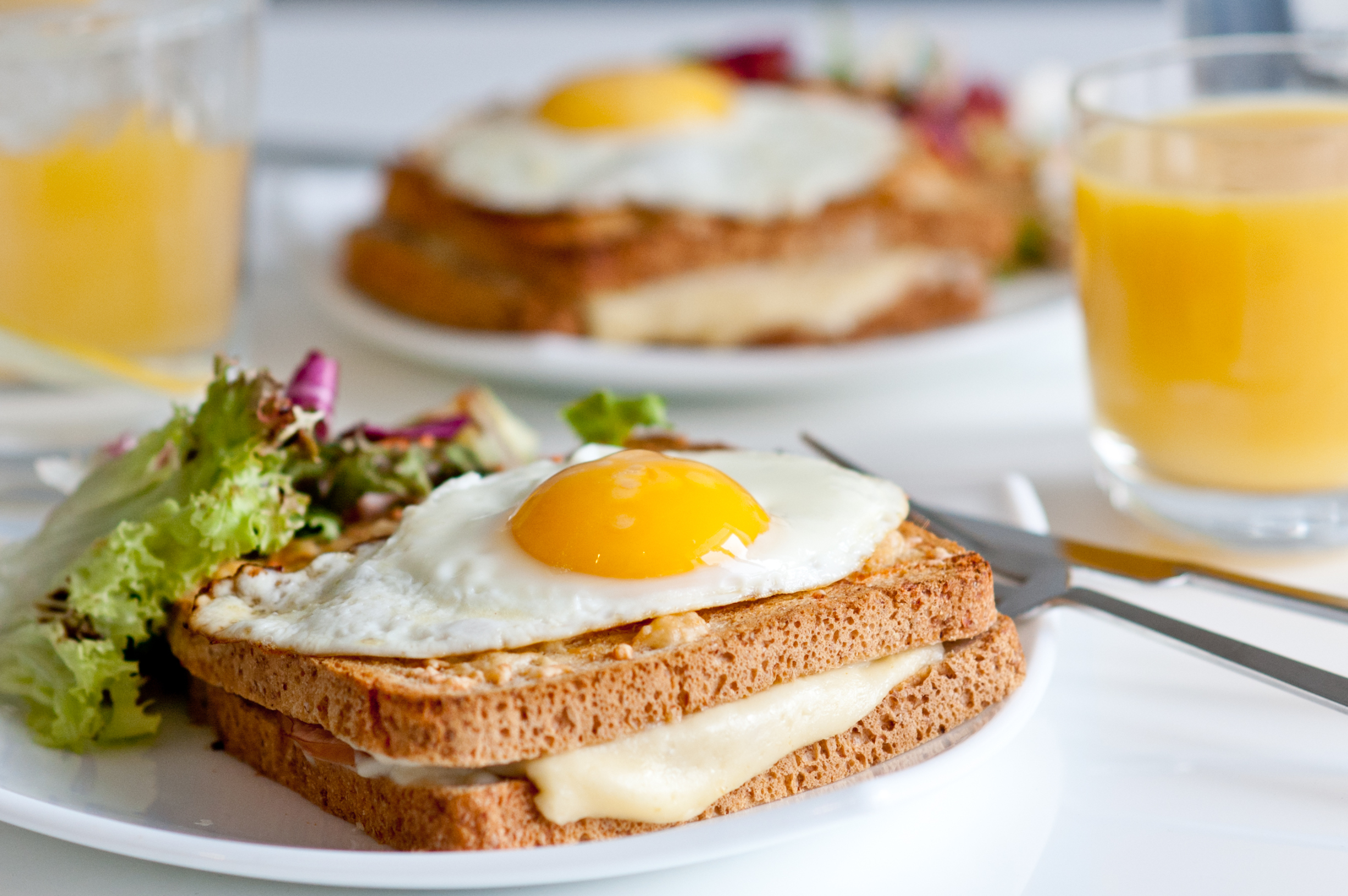 Croque madame with juice - traditional French breakfast