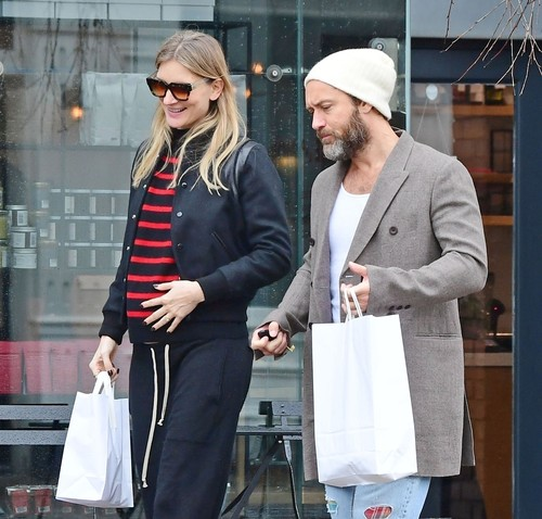 London, UNITED KINGDOM  - *EXCLUSIVE*  - WEB MUST CALL FOR PRICING - PICTURES TAKEN ON 08/03/2020 - The British Actor Jude Law sporting a bearded lookout for lunch in Primrose Hill with wife Phillipa Coan, it seems the sheepish couple may have something to tell us as Phillipa was cradling what looks like could be a baby bump and constantly trying to conceal her belly by pulling her jumper down as it kept riding up.   Jude has recently expressed how he would love to have a sixth child with Phillipa.  BACKGRID UK 20 MAY 2020, Image: 505264634, License: Rights-managed, Restrictions: , Model Release: no, Credit line: BACKGRID / Backgrid UK / Profimedia