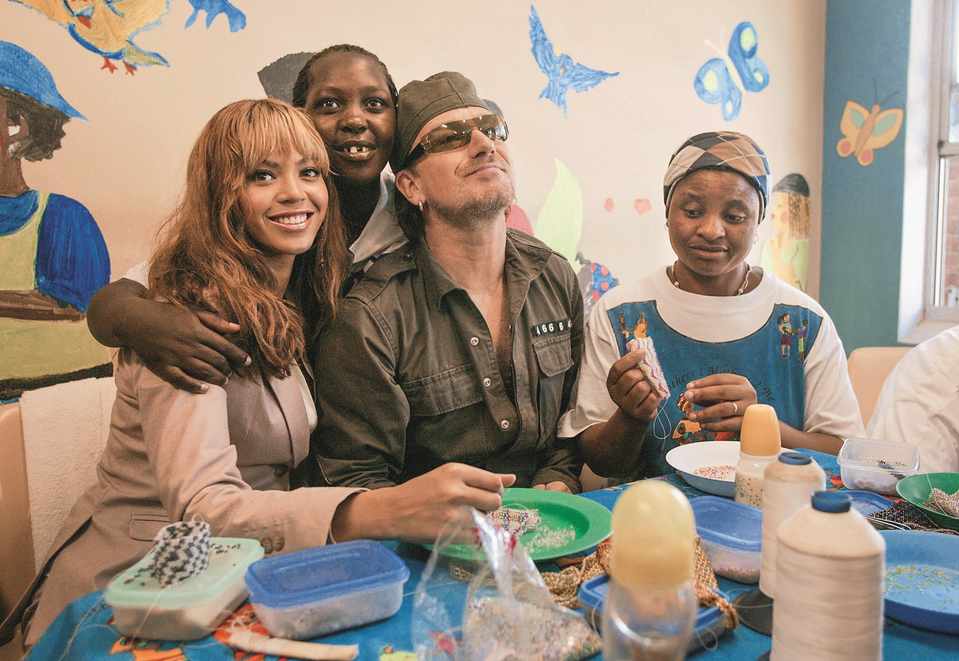 CAPE TOWN, SOUTH AFRICA - NOVEMBER 29:  Singer Bono and singer Beyonce Knowles visit the Baphumelele orphanage for children with AIDS whose parents have died of AIDS prior to the