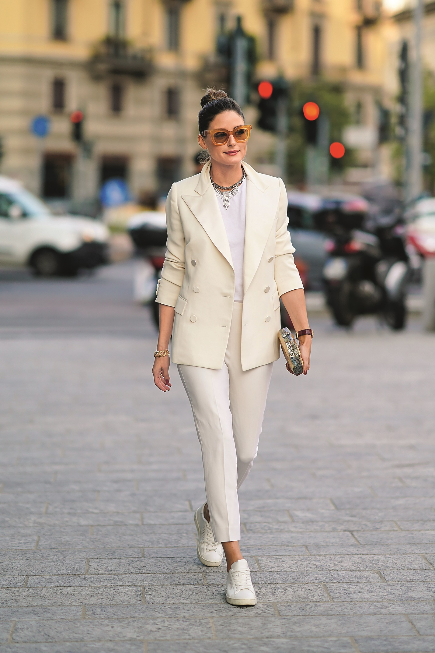 MILAN, ITALY - SEPTEMBER 18: Olivia Palermo wears brown sunglasses, a white blazer jacket, a necklace, a white t-shirt, cropped pants, sneakers, a golden clutch, outside the Alberta Ferretti show during Milan Fashion Week Spring/Summer 2020 on September 18, 2019 in Milan, Italy. (Photo by Edward Berthelot/Getty Images)