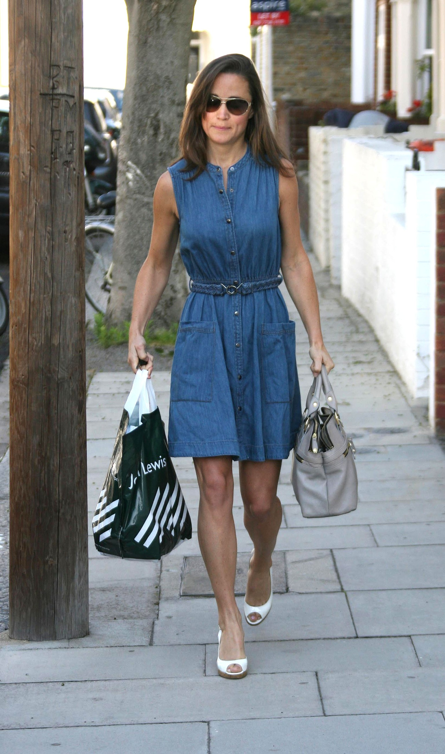 **EXCLUSIVE PICTURES FROM SOLARPIX.COM**                                             **WORLDWIDE SYNDICATION RIGHTS**                                                                                  It seems that Pippa Middleton and banker Alex Louden are still an item after she spends the night at Alex's Fulham home..Despite being seen in Madrid on the arm of handsom George Percy, who is heir to Alnwick Castle, since her rumoured split from Alex, Pippa now seems to have decided she still has feelings for Mr Louden..After lights out at 10.45pm, Alex left his home at 7.45am followed by Pippa at 8.15am wearing the same dress as the day before, but after realising she had been spotted, popped to the car to collect a John Lewis bag, before we.emerging from Mr Louden's house shortly after, wearing a blue denim dress..This pic:    Pippa Middleton leaving Louden's house after changing her dress                                                                                         JOB REF:    13608    EBR       DATE:   24.06.11                                                         **MUST CREDIT SOLARPIX.COM OR DOUBLE FEE WILL BE CHARGED**                                                                      **MUST AGREE FEE BEFORE ONLINE USAGE**                               **CALL US ON: +34 952 811 768 or LOW RATE FROM UK 0844 617 7637**, Image: 95945088, License: Rights-managed, Restrictions: **MUST CREDIT SOLARPIX.COM OR DOUBLE FEE WILL BE CHARGED****UNDER NO CIRCUMSTANCES IS THIS IMAGE TO BE REPRODUCED FOR ANY ONLINE EDITION WITHOUT PRIOR PERMISSION**, Model Release: no, Credit line: EBR / SOLARPIX / Profimedia
