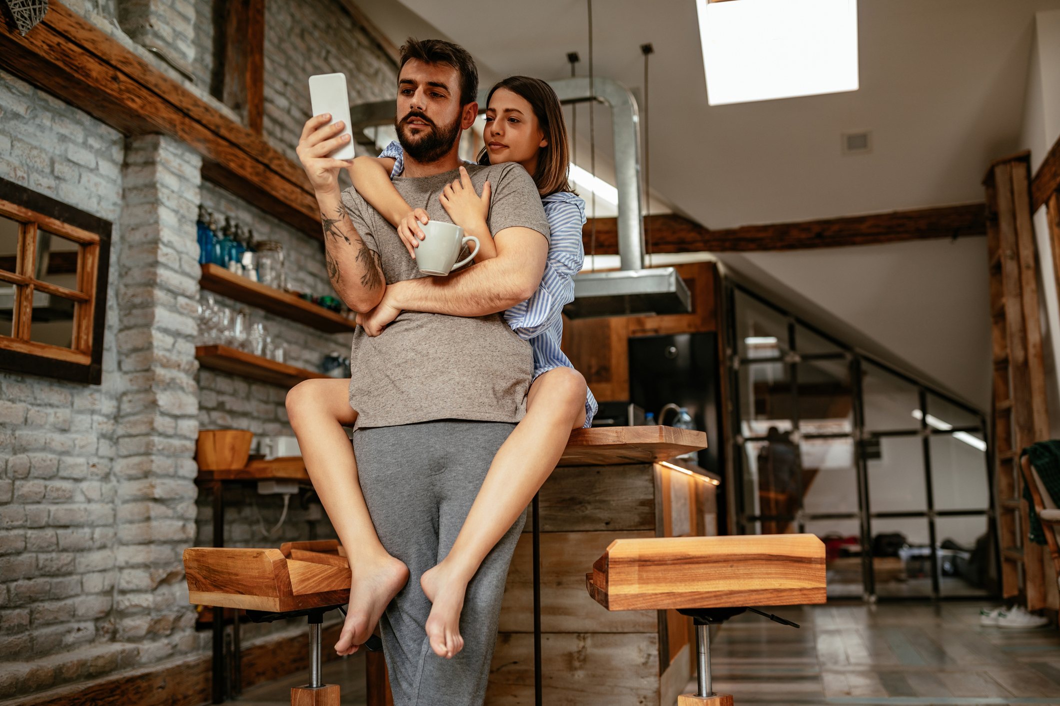Shot of an attractive young couple looking at a mobile phone