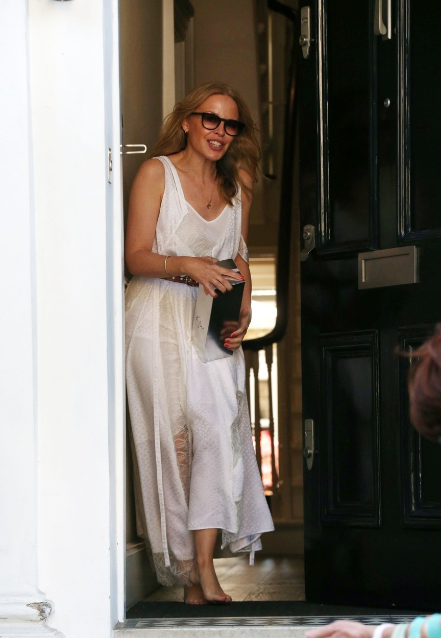 LONDON, UNITED KINGDOM  - *PREMIUM-EXCLUSIVE*  - MUST CALL FOR PRICING BEFORE USAGE - Australian pop princess Kylie Minogue is all smiles as she is pictured receiving gifts and flowers on her 52nd Birthday, It's also been reported that Kylie Minogue has launched a new £9 rose wine to mark her 52nd birthday and is on sale in Tesco supermarket!  *UK Clients - Pictures Containing Children Please Pixelate Face Prior To Publication*, Image: 523216065, License: Rights-managed, Restrictions: , Model Release: no, Credit line: Robs / BACKGRID / Backgrid UK / Profimedia