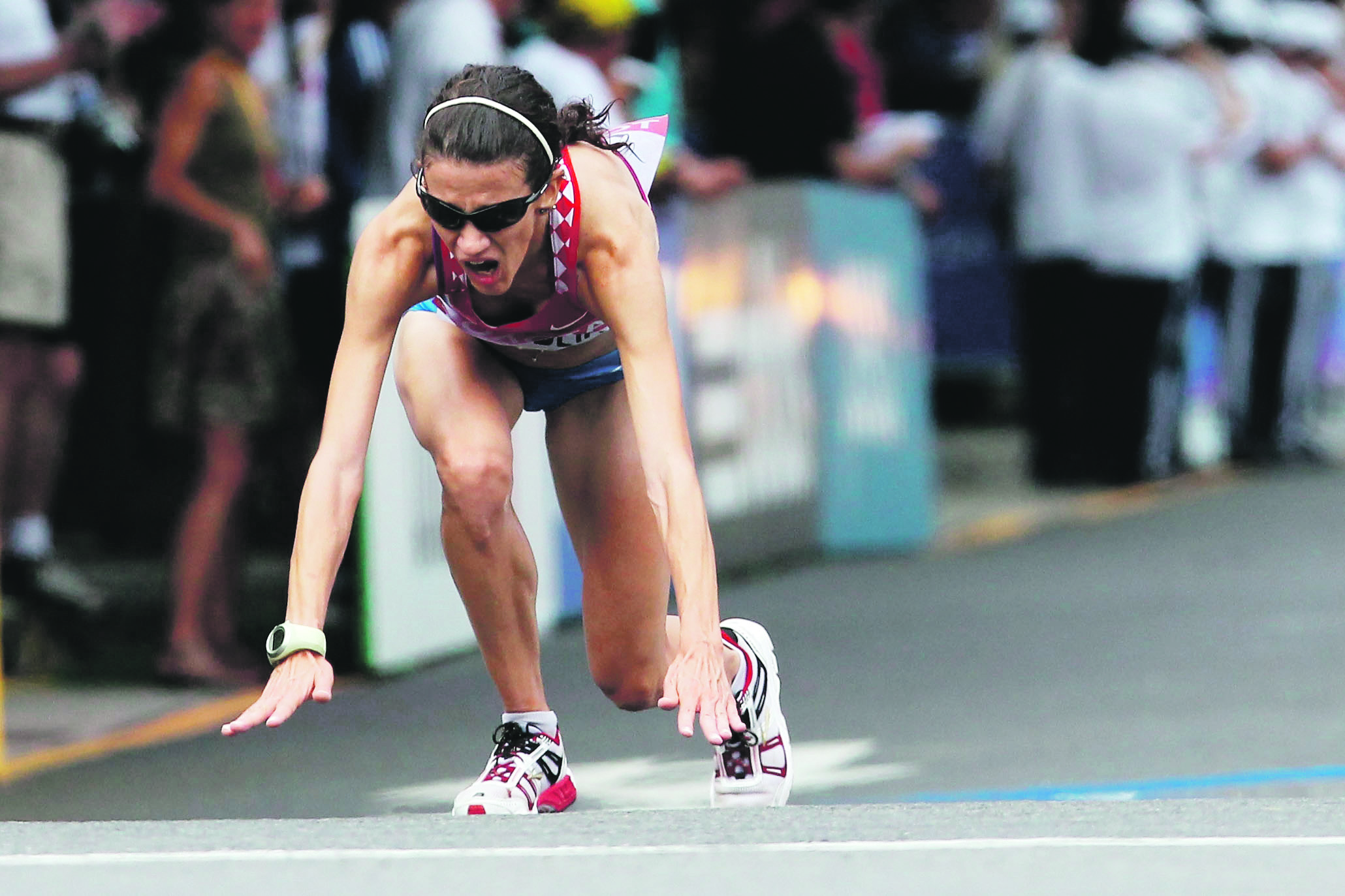 DAEGU, SOUTH KOREA - AUGUST 27:  Lisa Christina Stublic of Croatia falls at the finish line after competing in the women's marathon during day one of the 13th IAAF World Athletics Championships at the Daegu Stadium on August 27, 2011 in Daegu, South Korea.  (Photo by Chris McGrath/Getty Images)