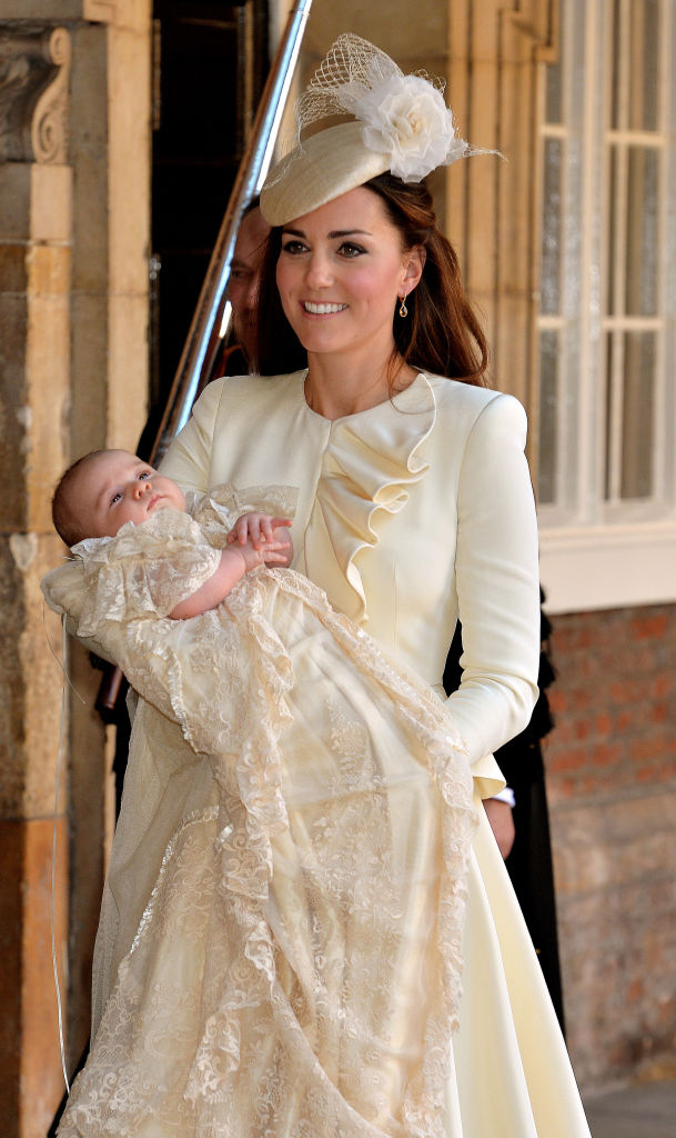 LONDON, ENGLAND - OCTOBER 23:  Catherine, Duchess of Cambridge carries her son Prince George Of Cambridge after his christening at the Chapel Royal in St James's Palace on October 23, 2013 in London, England. (Photo by John Stillwell - WPA Pool /Getty Images)
